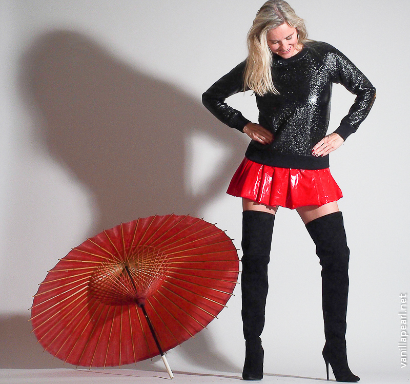 Christina, Vanilla Pearl, red vinyl skirt, black suede overknees and shiny Theory sweater