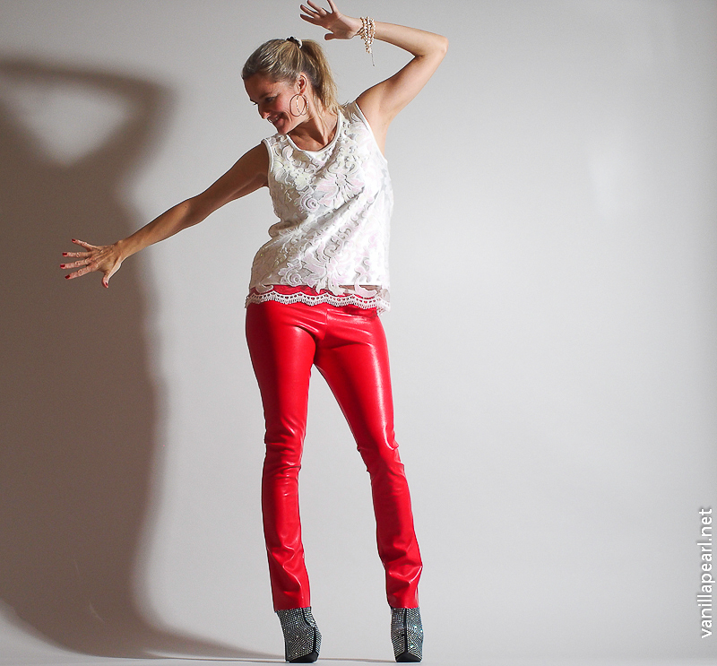 Christina, Vanilla Pearl, with red leather pants and white lace top from Arcanum Fashion